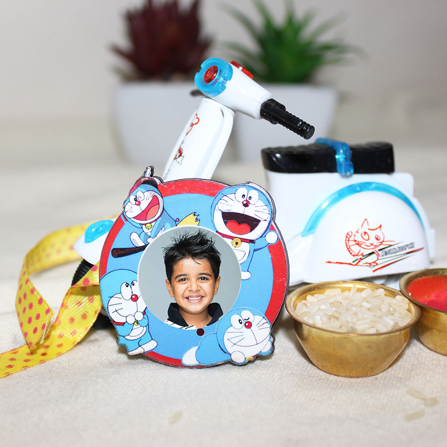 Doraemon Personalized Kids Rakhi with fridge magnate and Alloy Model Scotter